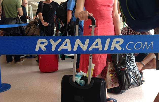 Ryanair passengers queue for their flight at Jerez Airport in Spain