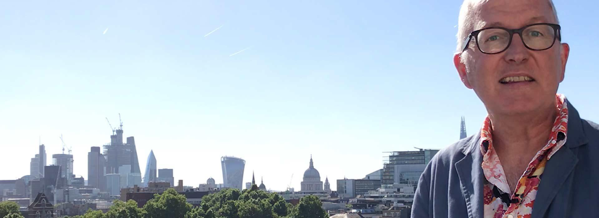 Chris Constantine against the London skyline